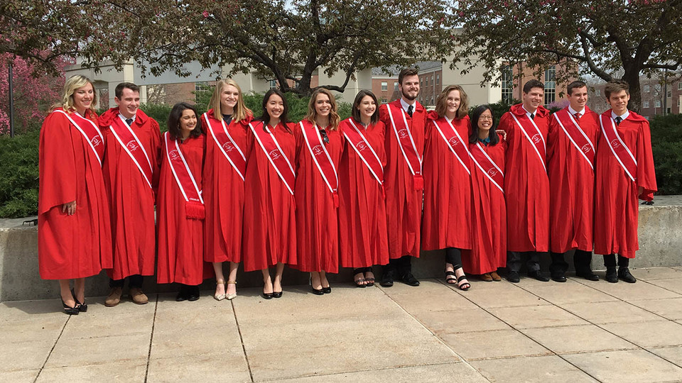 students in red gowns
