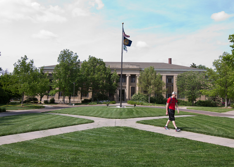 Student walking across East Campus