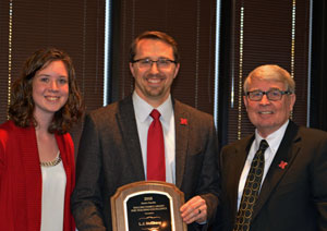 Dr. L.J.McElravy receiving Holling Family Award