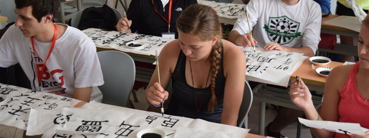 students on china study abroad trip writing at table
